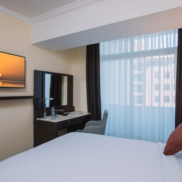 Best western plus Addis Ababa Suite room bed and TV